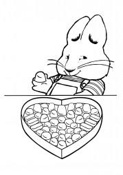 Кролик Макс ест конфеты